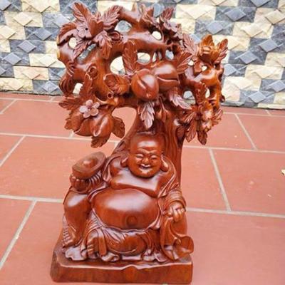 Ý Nghĩa Phong Thủy Phật Di Lặc Và Cây  Đào